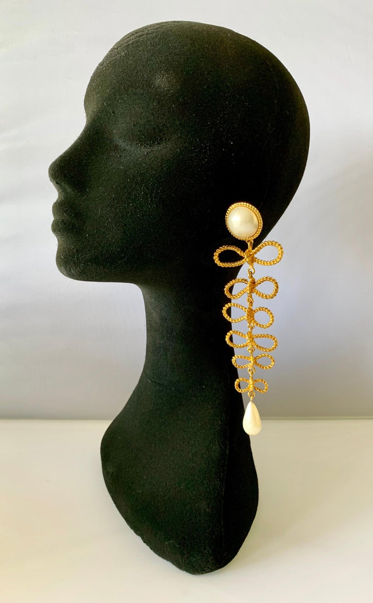 Scarce vintage Coco Chanel statement clip-on earrings - comprised out of gilt metal in a bow motif the earrings are adorned with large white pearls. Signed Chanel, from the Fall/Winter 1985 Haute Couture collection.