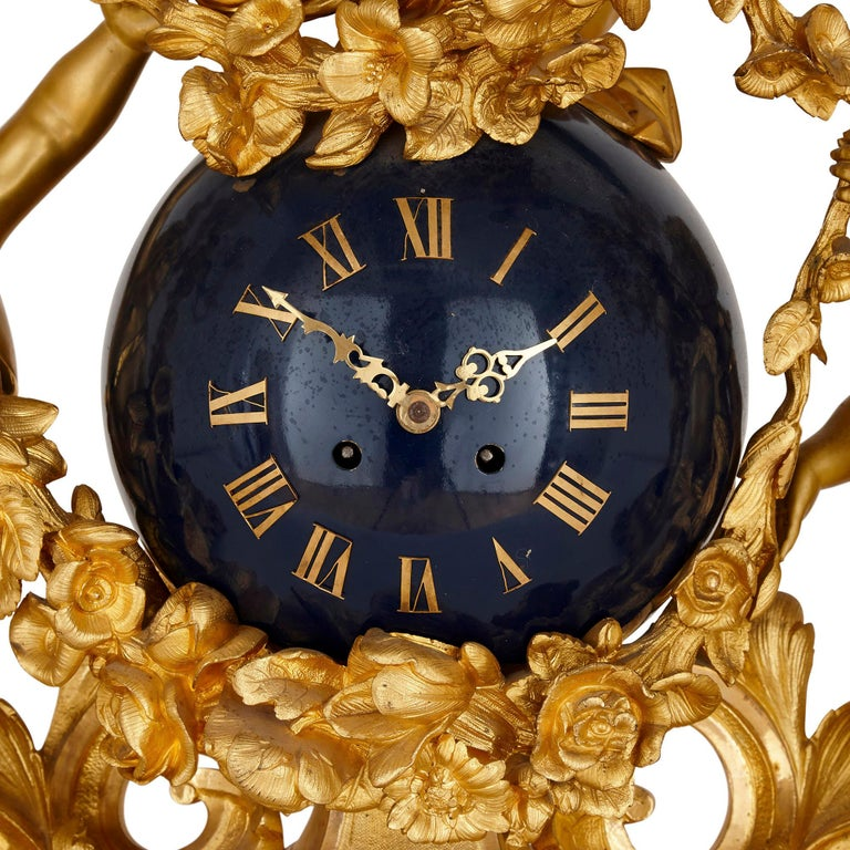 Neoclassical Large cherub-themed gilt bronze clock garniture by Popon For Sale