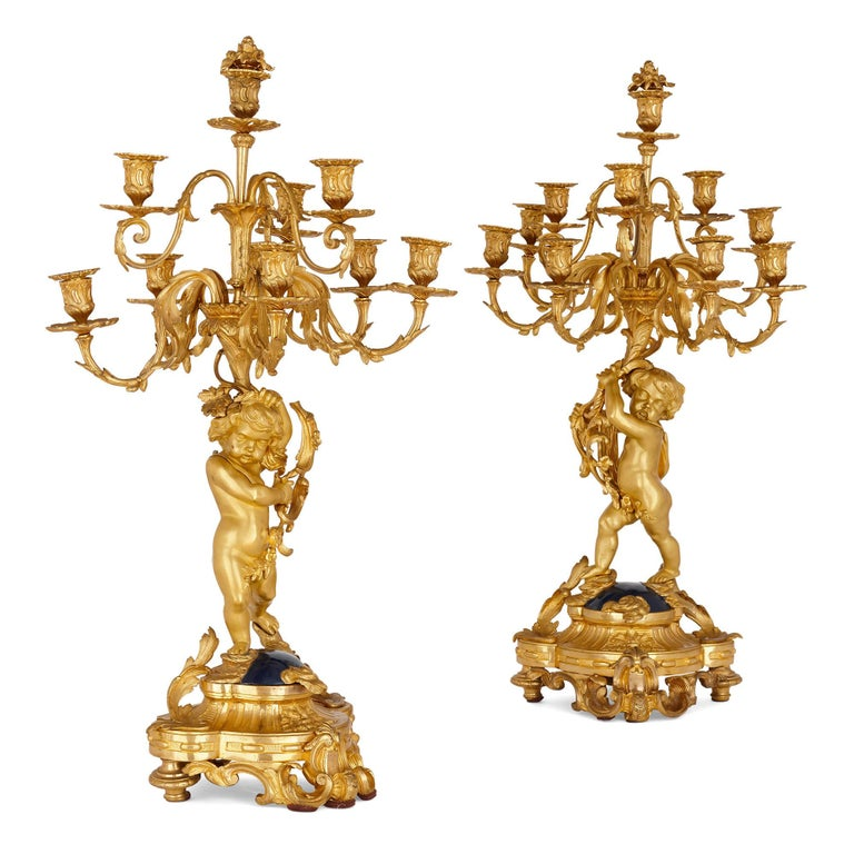 Large cherub-themed gilt bronze clock garniture by Popon In Good Condition For Sale In London, GB