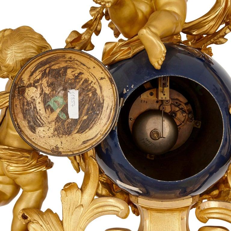 19th Century Large cherub-themed gilt bronze clock garniture by Popon For Sale