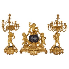 Large cherub-themed gilt bronze clock garniture by Popon