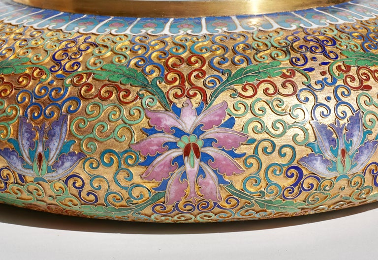 A Chinese cloisonné enamel alms bowl. With intricately detailed decoration. Interior decorated with chrysanthemums. A stunning and intricate piece of metalwork. Would make a wonderful centerpiece or planter. 20th century.  Measures: Height 4.5