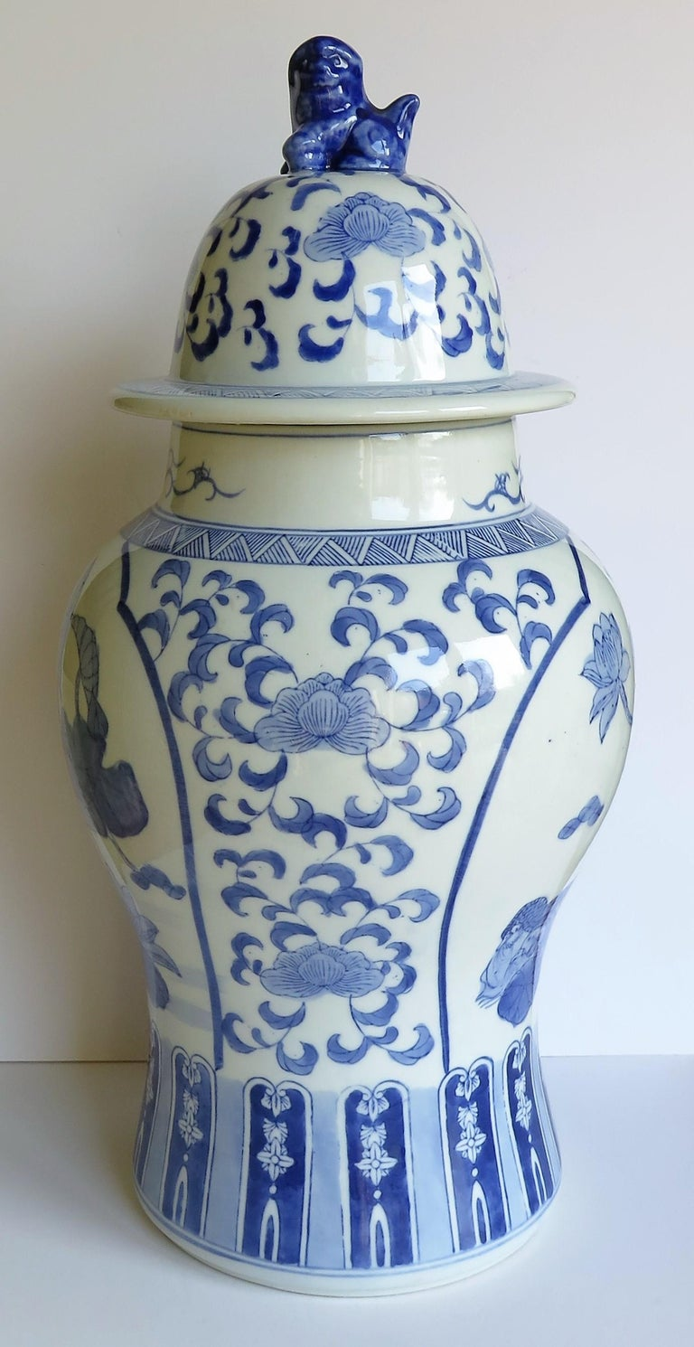 This is a beautiful large Chinese, blue and white porcelain lidded vase or Jar, hand painted with Water Lilies and Mandarin ducks, which we date to the mid-20th century.  The vase has a good well potted baluster shape with a lid having a foo dog