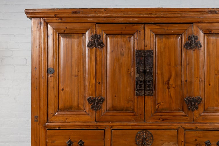 Large Chinese Qing Dynasty Style Wooden Cabinet with Paneled Doors and Drawers In Good Condition For Sale In Yonkers, NY