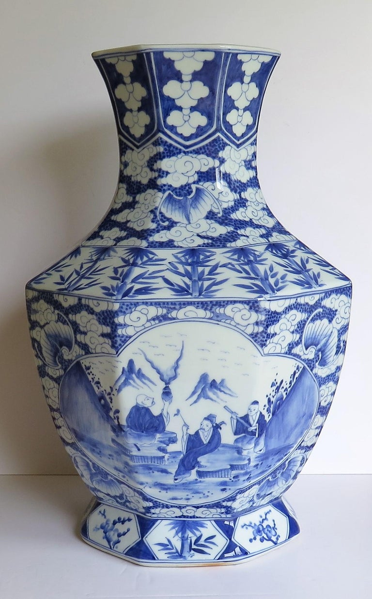 This is a very impressive and beautifully hand painted porcelain Chinese baluster Vase raised on a footed base and dating to the early 20th century, circa 1920.