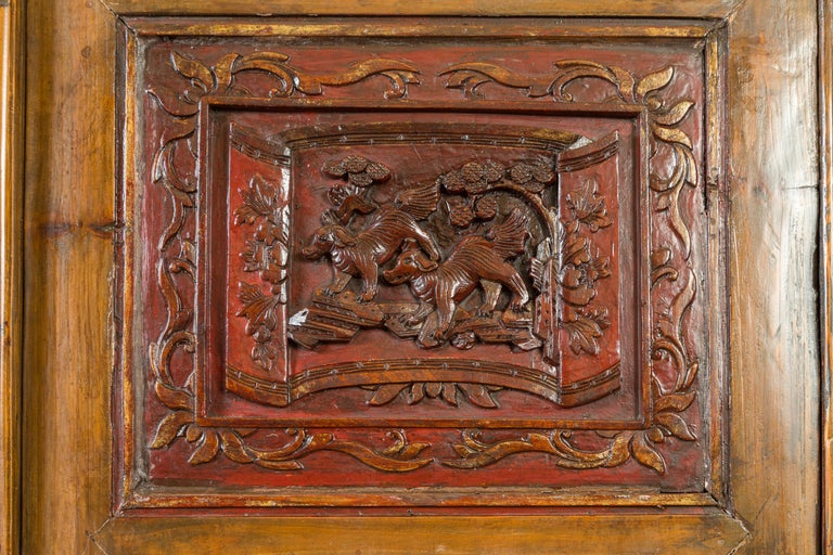 Large Chinese Qing Elm Armoire with Carved Motifs and Red Lacquered Accents For Sale 5