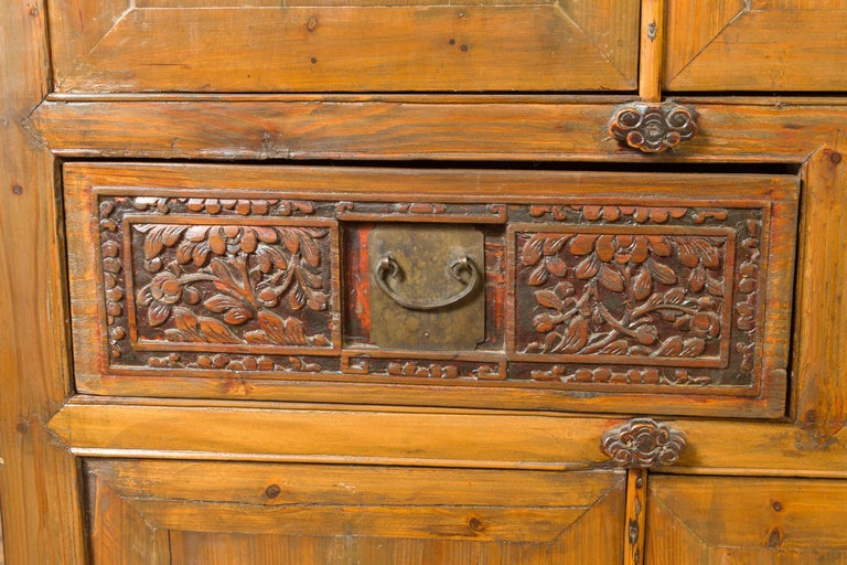 Large Chinese Qing Elm Armoire with Carved Motifs and Red Lacquered Accents For Sale 7