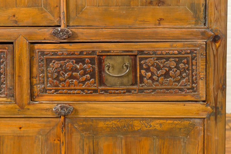 Large Chinese Qing Elm Armoire with Carved Motifs and Red Lacquered Accents For Sale 8