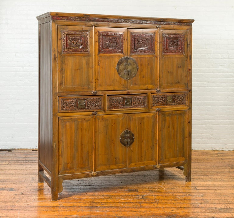 Hand-Carved Large Chinese Qing Elm Armoire with Carved Motifs and Red Lacquered Accents For Sale