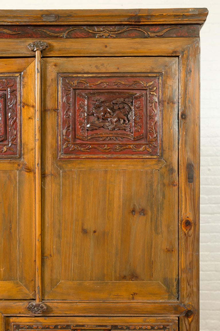 Large Chinese Qing Elm Armoire with Carved Motifs and Red Lacquered Accents For Sale 1