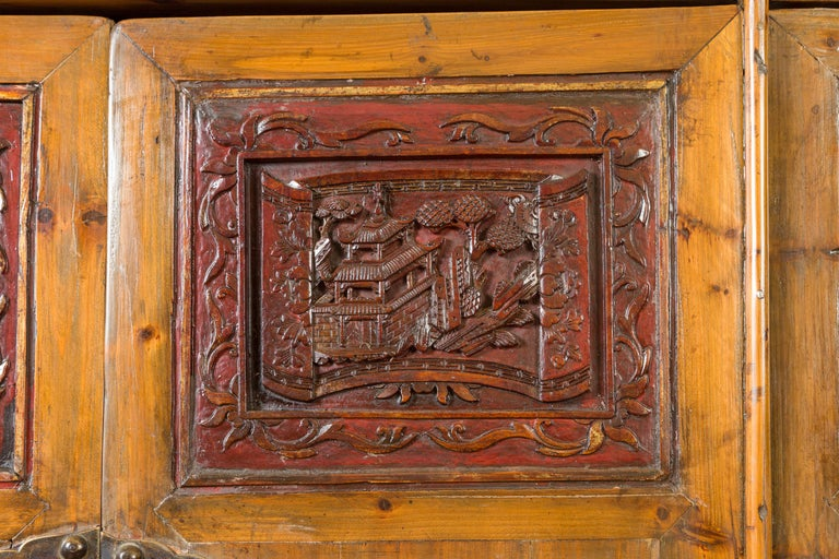 Large Chinese Qing Elm Armoire with Carved Motifs and Red Lacquered Accents For Sale 4