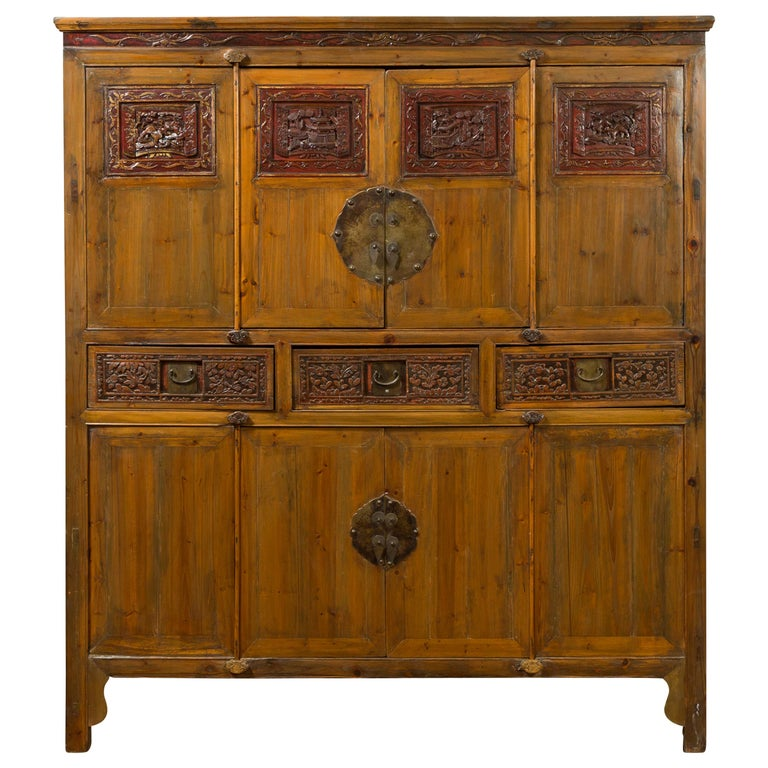 Large Chinese Qing Elm Armoire with Carved Motifs and Red Lacquered Accents For Sale