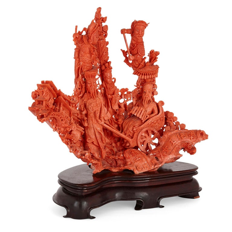 Large Chinese sculpted coral depicting a dignitary and attendants Chinese, early 20th Century Measures: Height 38cm, width 40cm, depth 20cm  Taking beautiful natural red coral as a medium, this magnificent piece of Chinese sculpture is a