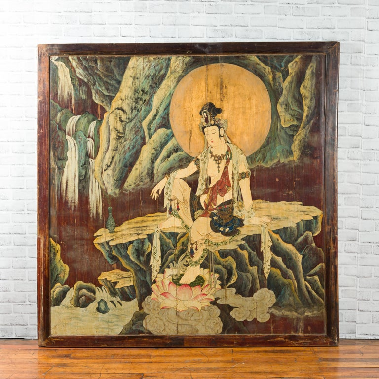 An antique Chinese unusual large hand painted two-sided elm divider depicting Guanyin and Zhong Kui, from the first half of the 20th century. Handcrafted in China, this large rectangular elmwood screen divider is painted with numerous colors on a