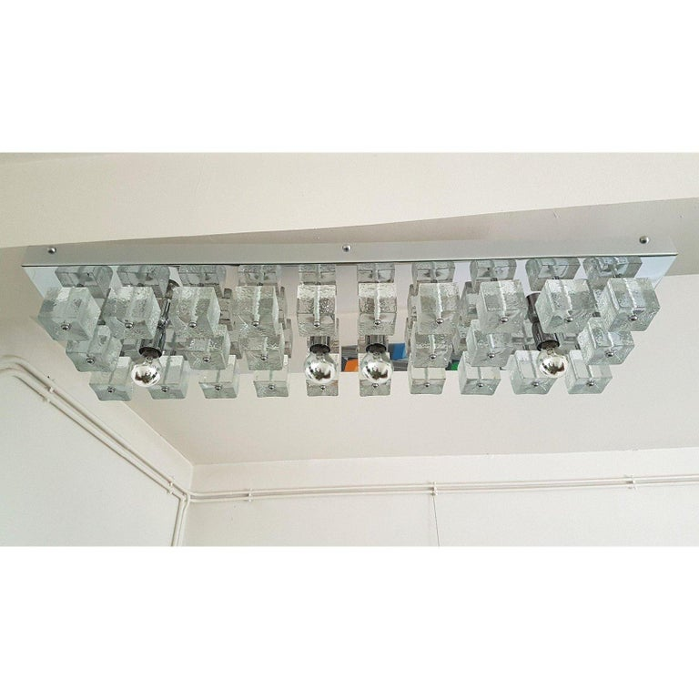 Large rectangular shape, chrome and Murano clear glass cubes flush mount ceiling light. Attributed to Gaetano Sciolari for Lightolier, Ice Cube model, Italy, 1970s. The chrome flush mount has 4 lights, medium base, rewired. Very low height: perfect