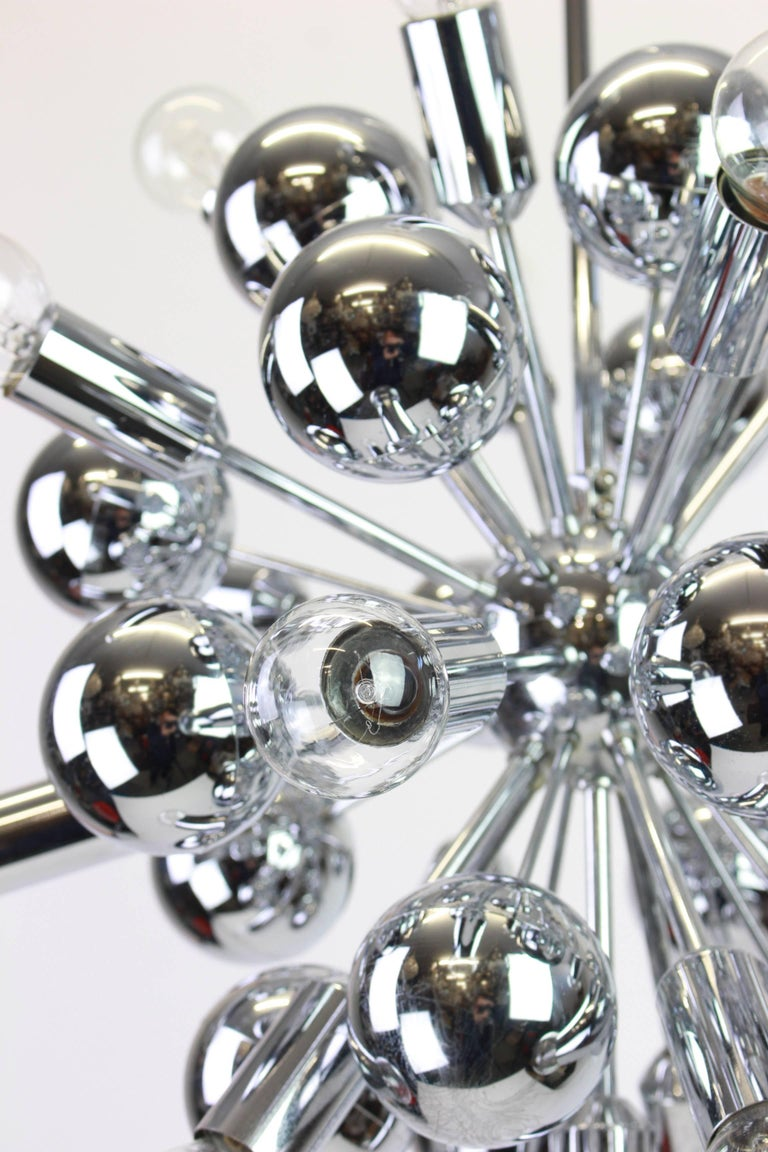 Exclusive silver Sputnik pendant lamp designed by Cosack during the 1970s.  Sockets: It needs 21 x E14 small bulb and function on voltage from 110 till 240 volts. Dimensions:  Diameter: 16