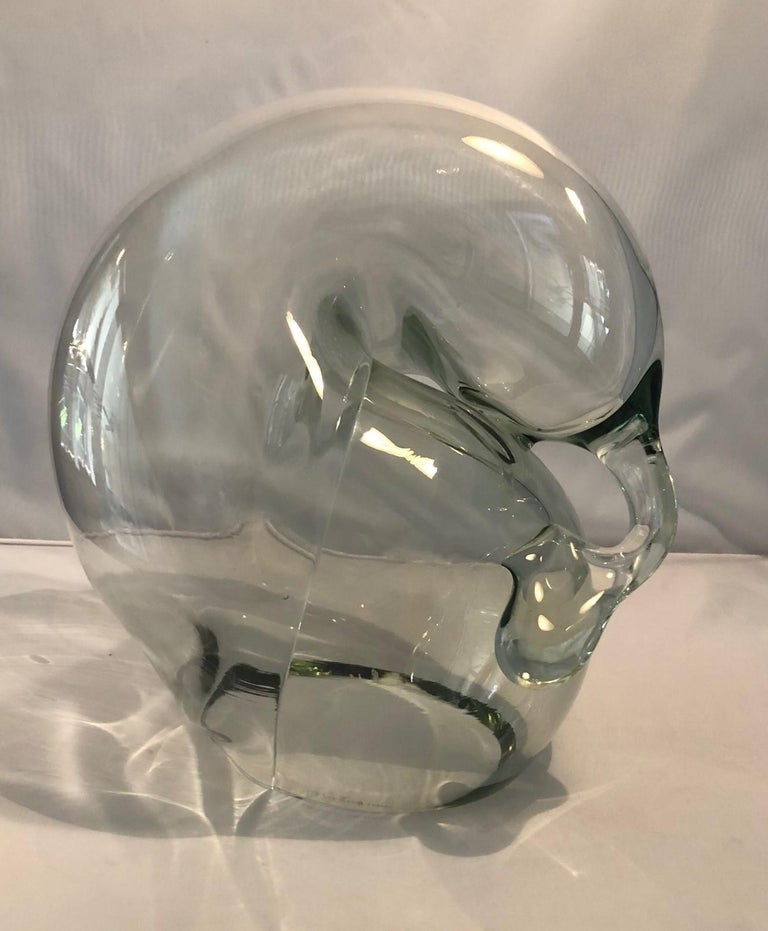 Large clear art glass orb sculpture by John Bingham, circa 1980s. This hand blown glass orb sculpture has a biomorphic free form design and is in very good condition with no chips or cracks. The piece is approximately 10