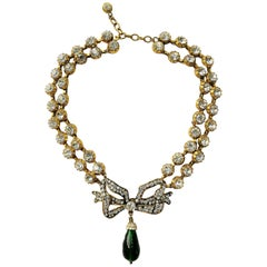 Large clear paste and emerald poured glass  'bow' necklace, Chanel, 1980s