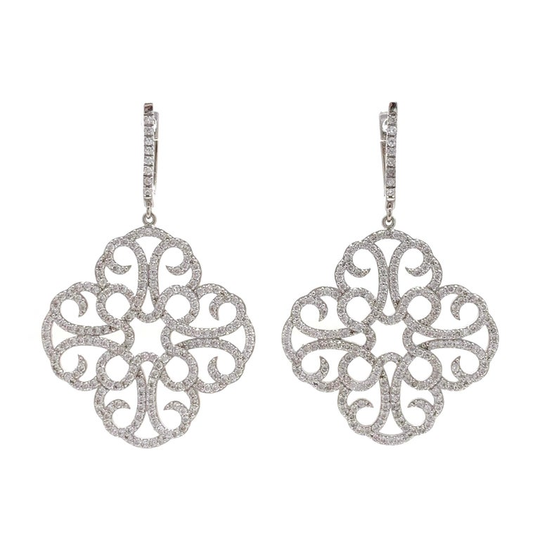 Large Clover Faux Diamond Drop Sterling Silver Earrings  The earrings feature over 400 pcs of AAA quality round faux diamond cz , handset in platinum rhodium plated sterling silver.  Straight post with English lock closure. The earrings measured 2
