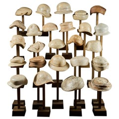 Large Collection of 25 Wooden Hat Forming Shape Models on Custom Made Stands