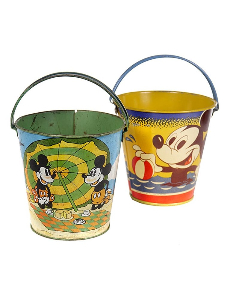 There are 11 different pails in this collection. They are signed Disney, Kirchhof, Chain, Ohio Art and Japan etc. The largest is 6