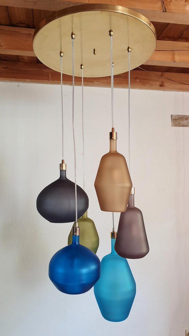 Very large pendant flushmount light, Mid-Century Modern, attributed to Leucos 1980s. Made of six colorful translucent Murano glass pendants, with various shapes and sizes, and a polished brass ceiling plate. One light in each glass, with a
