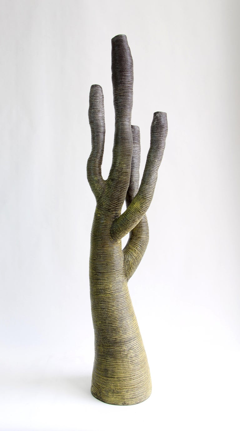 Large green stoneware tree created by Julie Bergeron. The organic forms and rich textures express the intense beauty of nature in all its irregularity. Rich variations in color, from deep brown/black to pale green highlights, vibrate with the