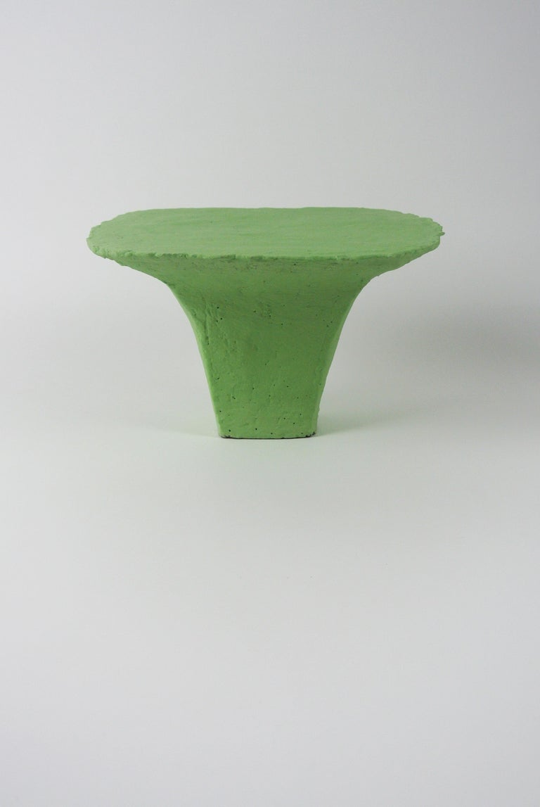 Large grey stoneware platform with matte lichen green engobe. Raw, rounded edges and fire sand visible on the surface. For decoration only.  All pieces by Christine Roland celebrate the imperfections that occur from working with a natural material.
