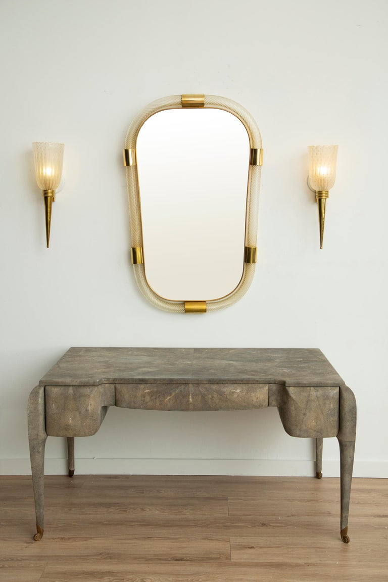 Contemporary twisted Murano glass and brass frame mirror, in stock Light gold/ yellow with solid brass accent Inner thin brass gallery Pair available Handcrafted by a team of artisans in Venice, Italy. Located in our store in Miami ready for