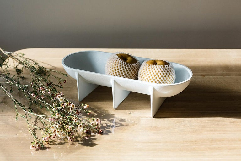 Place this unique design on a favorite table for the perfect centerpiece or enjoy in the kitchen as a special fruit bowl.   The die cast aluminum standing bowl is elevated off the table surface by its architecturally inspired planar legs. Each