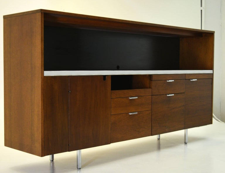 George Nelson Herman Miller, Executive Office Group (EOG) Series circa 1962 Lacquered walnut, steel and chrome. Measures: 80.75 wide x 18.5 deep x 43 inch tall  Customized for a client, this large credenza boasts storage more akin to a desk and