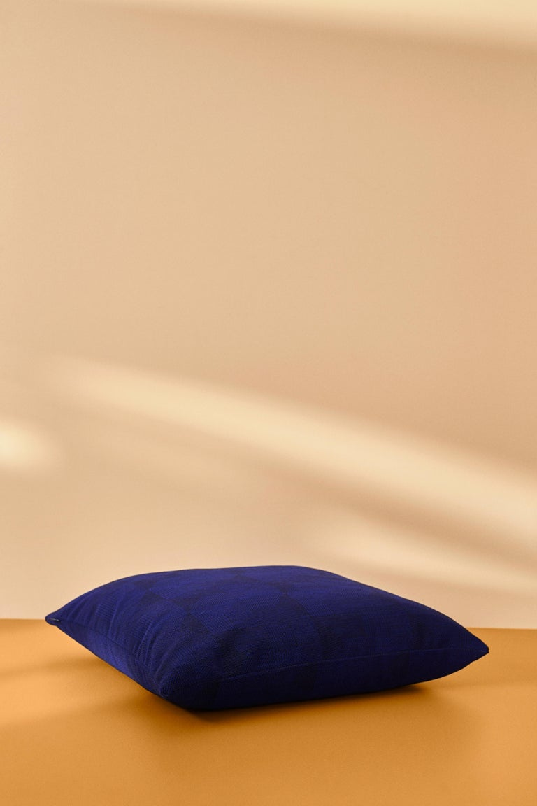Beautiful graphic cushion in exclusive Kvadrat fabric. Its beautiful geometric pattern and intense tone-on-tone color combinations make the Crystal Field a luxurious addition to any living room, bedroom or kitchen bench. The fabric for the Crystal