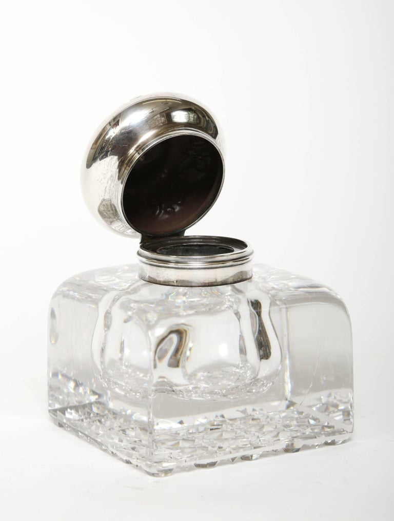 Large 19th century blown crystal inkwell with a hand-cut base in the cane pattern. When fabricated an air bubble was created inside to hold the ink. The sterling silver hinged top was made by The Old Gorham Silver Company of Providence, Rhode Island