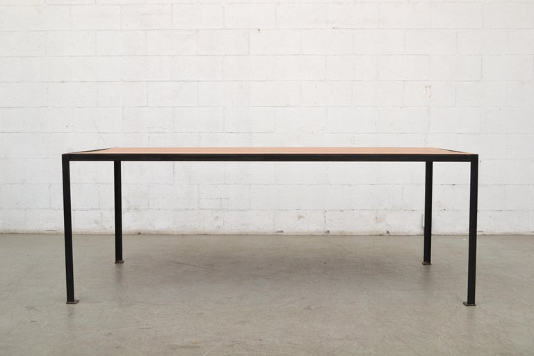 Large custom industrial dining or conference table with vintage solid pecan top and new black enameled metal frame. Top in good original condition with peg fastening detail.