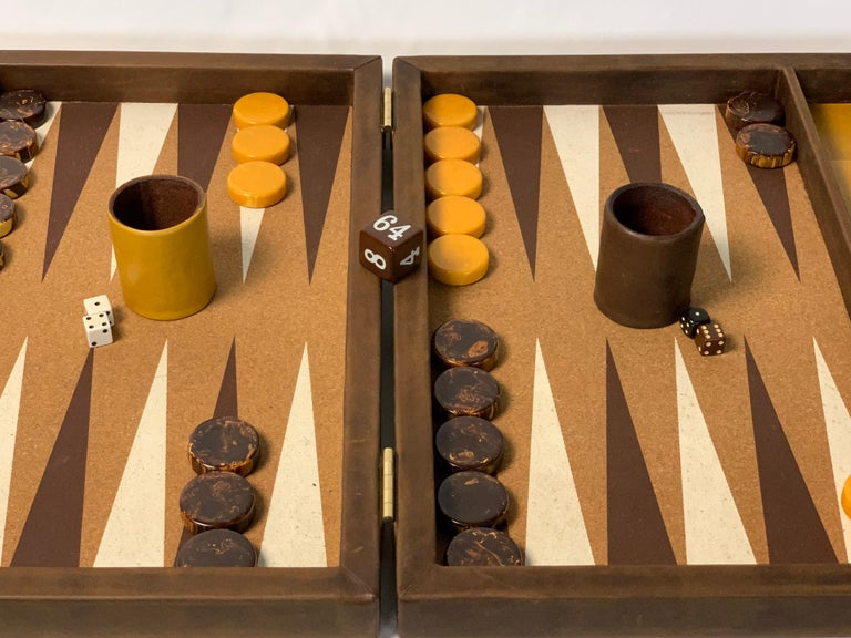 A large and impressive bespoke backgammon set done in chocolate brown and mustard yellow leather with cork playing surface and large bakelite playing pieces.