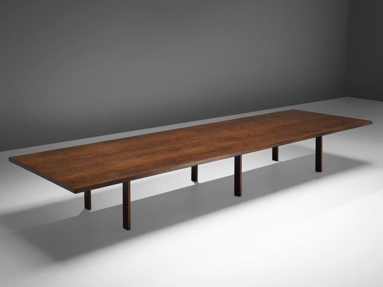 Dining or conference table, wengè, Denmark, 1960s.  This unique Minimalist, modest table is completely executed in wengé. The top shows a bookmatched wengé veneer, resulting in a jaw dropping pattern of natural flames of the tropical wengé. This