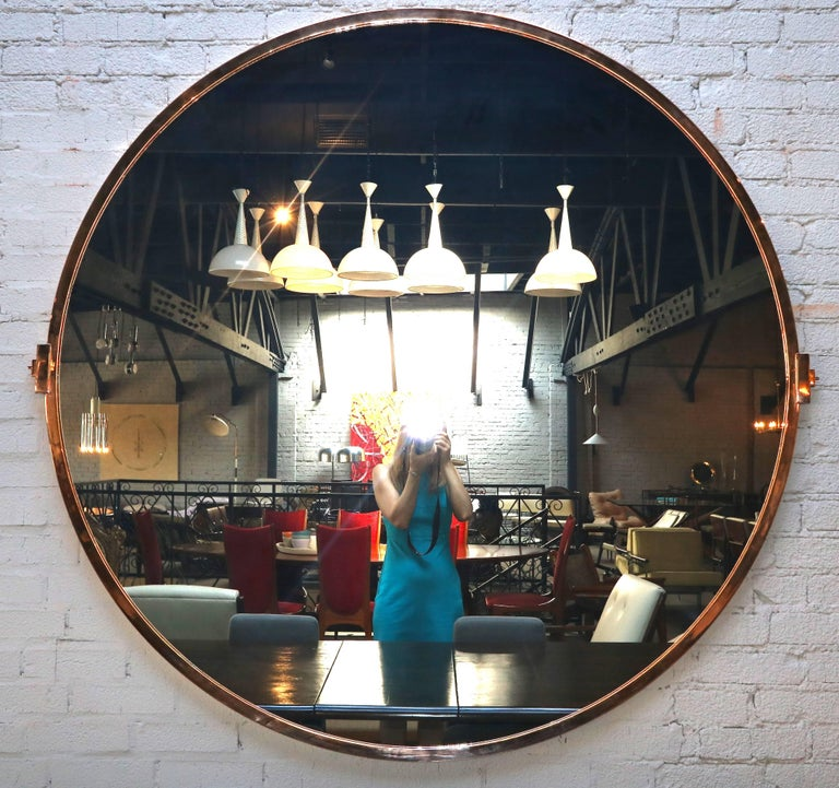 Large custom 5-foot copper mirror  by Adesso Imports.  Can be done in different shapes, sizes and finishes