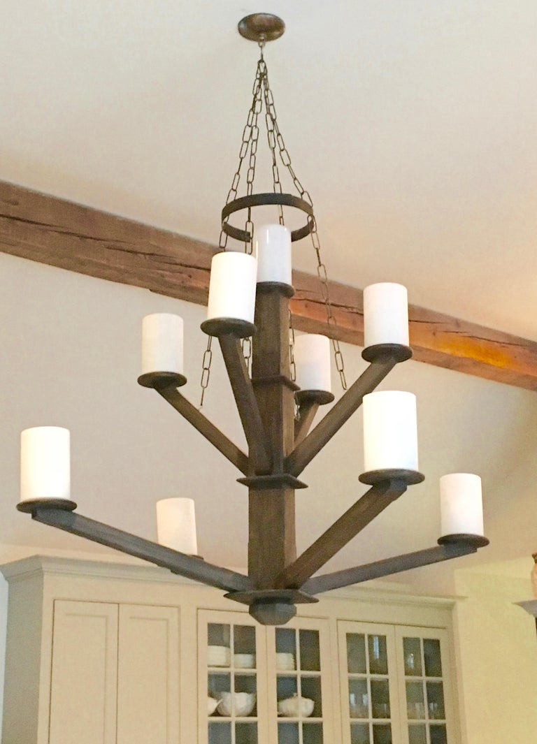 Large Avantgarden custom-made black walnut wood chandelier, with iron details and shown with milk glass cylinder shades.  Custom woods and stain options are available.  Avantgarden has been cultivating great lighting, furniture and design in Pound