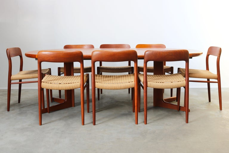 Very large and rare dining room set designed by Niels Otto Møller and produced by J.L Mollers in the 1950s. The set has eight Model 75 chairs in teak and papercord. And a large round (twice extendable) table in teak.