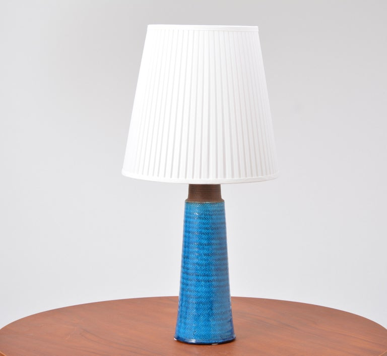 Large Turquoise Danish Mid-Century Modern Stoneware table lamp by Nils Kähler  This stoneware table lamp was designed by Nils Kähler and made in the 1960s by Herman A Kähler Ceramic (HAK) in Denmark. It has a turqouise colored glaze covering. The