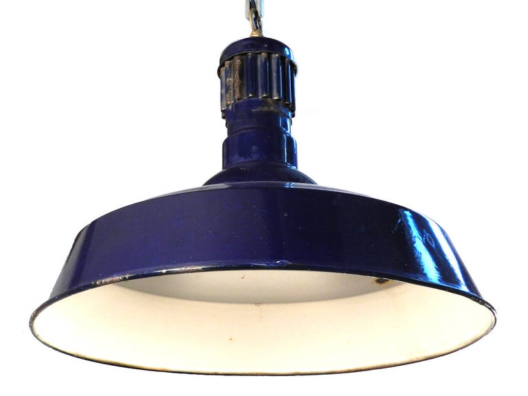 This is a good size pendant, it has a 20 inch diameter and is 16 inches tall. These blue porcelain fixtures are uncommon and a nice change from the typical white and green examples. It does show some surface rust in a few spots but saying it has an