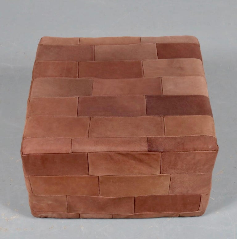 Large patchwork leather ottoman by De Sede in brown. Patchwork leather with great coloring and patina to leather. Very good condition. Great accent piece.