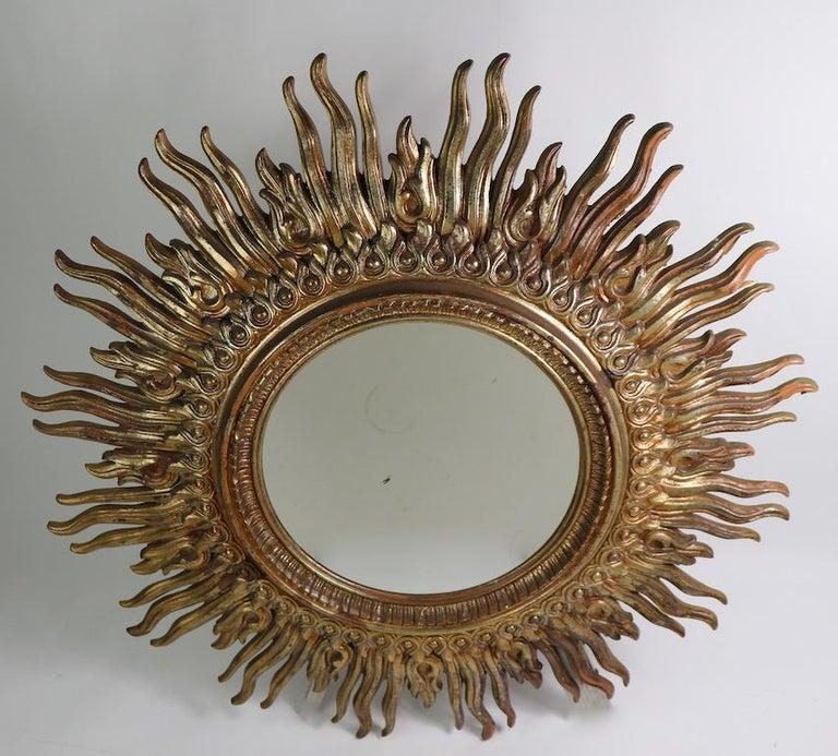 Hollywood Regency Large Decorative Sunburst Starburst Mirror with Cast Plastic Frame For Sale