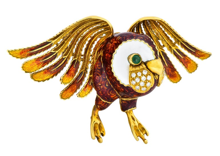 Designed as a three dimensional owl with textured detailed feathers and diamond accented cheeks   Colored enamel on wings and body with white enamel throughout the face   Round brilliant diamonds weighing approximately 0.53 carat total, E-F color