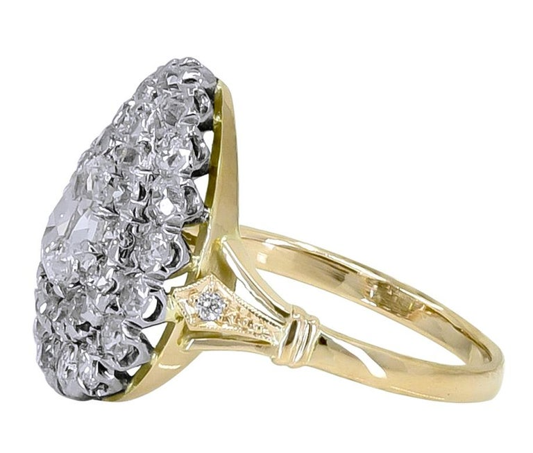 Sparkling diamond ring.  The center is a pear-shaped .70 ct. diamond. Surrounded by two rows of brilliant cut diamonds, approximately 2.30 cts.   All original, meticulously made by hand.  Set in 18K yellow gold and platinum.  Size 7 and can be