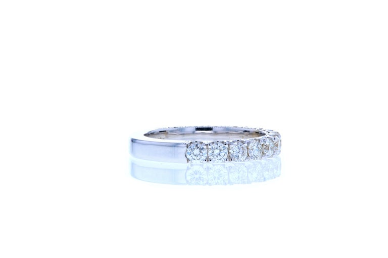This classic diamond wedding band features larger than normal size diamonds to elevate the look. It features 15 round brilliant cut diamonds and is set in 18K white gold. This style of wedding band can be made in any color metal and with larger or