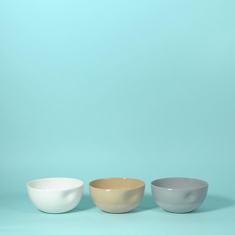 Middle Kingdom dimpled porcelain bowls are designed by Carola Zee of Rotterdam, Holland. Each bowl is molded and then dimpled by the hand of the potter to create a unique and comfortable hold. There are three sizes available, three colors, and