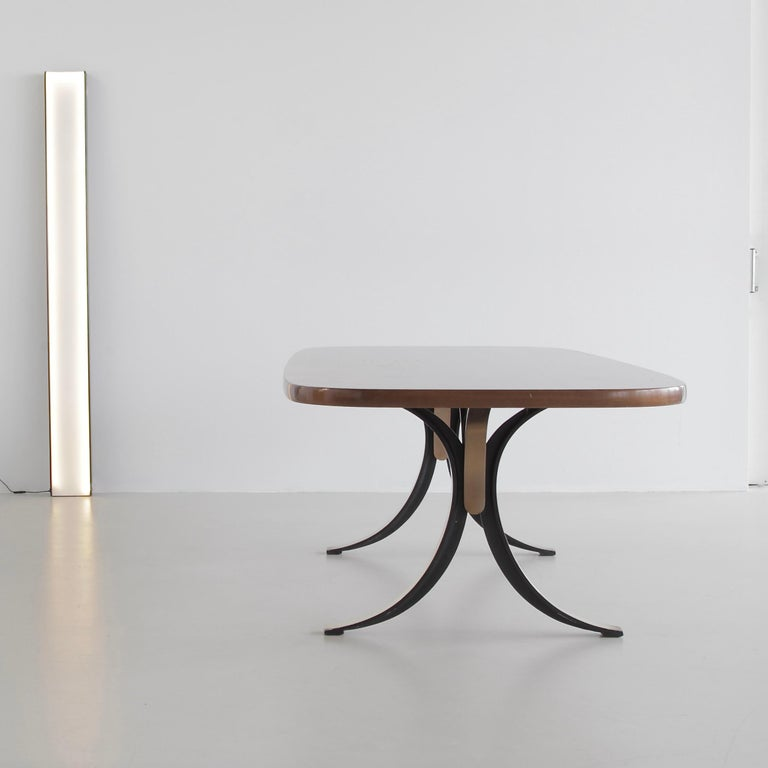 Large dining table or desk (T102A) designed by Osvaldo Borsani in 1963/64. Produced by TECNO.  Brass colored metal on single cast base with the inner sides finished in matt black enamel. Original thick wooden tabletop. Rare.  Literature:  -