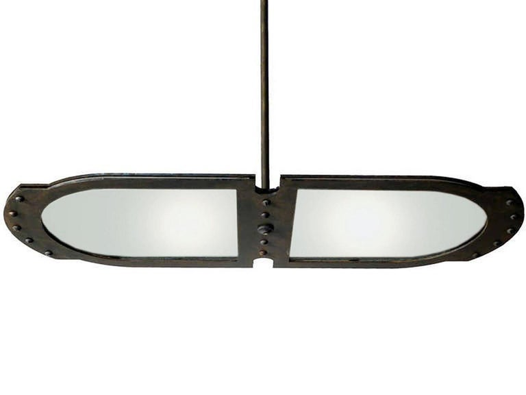 This large tracery style Industrial pendant fits comfortably with most styles. It's very architectural with clean lines… just look at the profile. The heavy steel frame has an aged patina and Industrial accents that are not over done. We designed