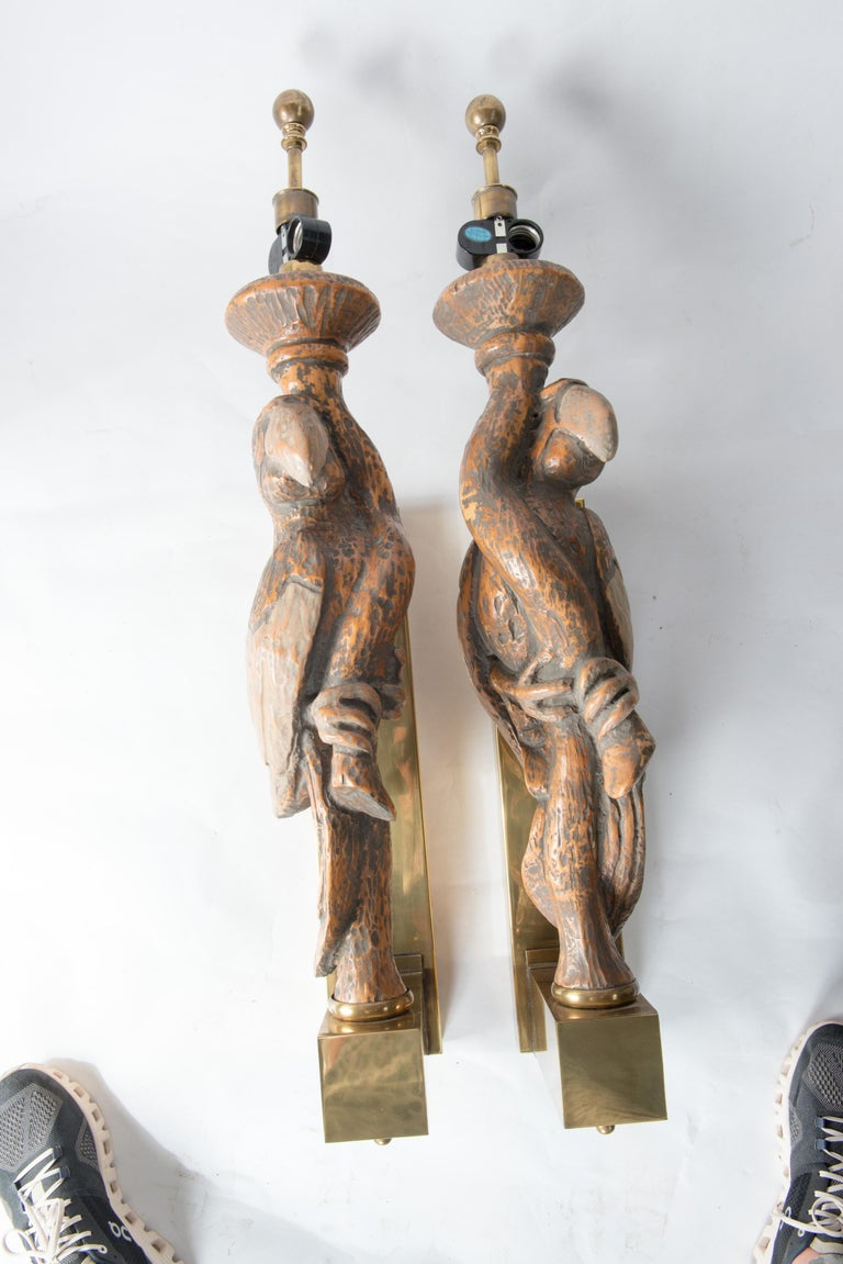 Manufactured by Hart & Associates a large pair of parrot sconces mounted on large brass boxed back plates.  Each sconce holds two standard light bulbs. These are meant to have lampshades. Stunning for a pool house or a garden room.